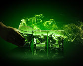 Three glasses of green absinth with ice cubes — Stock Photo