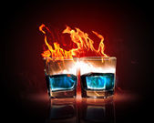 Two glasses of burning emerald absinthe — Stock Photo