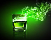 Glass of green absinth — Stock Photo
