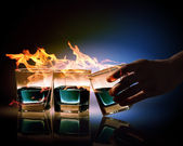 Three glasses of burning emerald absinthe — Stok fotoğraf