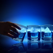 Three glasses of blue liquid — Stock Photo