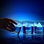 Three glasses of blue liquid — Stock Photo