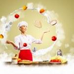 Juggler female cook — Stock Photo #21131491