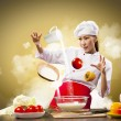 Asian female cooking with magic - Stok fotoğraf