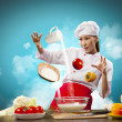 Asian female cooking with magic — Stock Photo #21137387