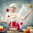 Asian female cooking with magic — Stock Photo #21137399