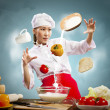 Asian female cooking with magic — Stock Photo