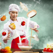 Asian female cooking with magic — Stock Photo #21137469
