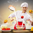Asian female cooking with magic - Stock Photo