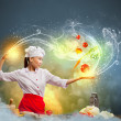 Stock Photo: Asifemale cooking with magic