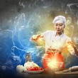Asian female cooking with magic - 