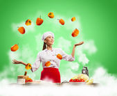 Juggler female cook — Stock Photo