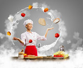 Juggler female cook — Stockfoto