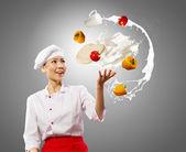Juggler female cook — Stock Photo