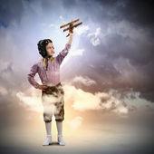 Little girl in pilot's hat — Stock Photo