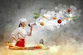 Asian female cook holding megaphone — Stock Photo