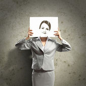 Business woman with drawing — Stock Photo
