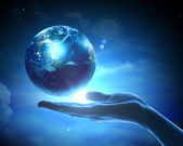 Image of earth planet on hand — Stock Photo