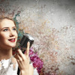 Female blonde singer — Stock Photo #21216985