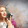 Female blonde singer — Stock Photo #21217009