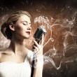 Female blonde singer — Stock Photo