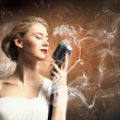 Stock Photo: Female blonde singer