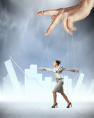 Business woman marionette — Stock Photo