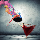 Ballet dancer in flying satin dress with umbrella — Photo