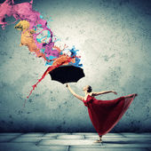Ballet dancer in flying satin dress with umbrella — Stok fotoğraf