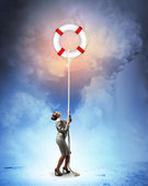Image of businesswoman climbing the rope — Stock Photo