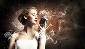 Female blonde singer — Stock Photo