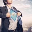 Businessman showing superman suit underneath shirt - Stock fotografie