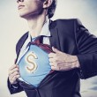 Businessmshowing supermsuit underneath shirt — Stock Photo #21239809