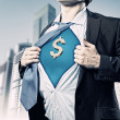 Businessman showing superman suit underneath shirt — Stock Photo