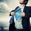 Young superhero businessman - Stock Photo