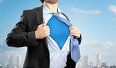 Young superhero businessman — Stock Photo