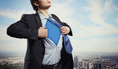 Young superhero businessman — Stockfoto