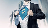 Businessman showing superman suit underneath shirt — Zdjęcie stockowe