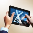 Dna strand On The Tablet Screen — Stock Photo #21246603