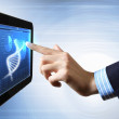 Dna strand On The Tablet Screen — Stock Photo