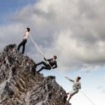 Three business pulling rope — Stock Photo #21248365