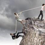 Three business pulling rope — Stock Photo #21248371