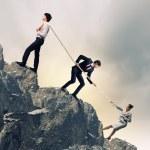 Three business pulling rope — Stock Photo #21248383
