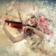 Gorgeous woman playing on violin — Stockfoto
