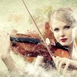Gorgeous woman playing on violin - Stock Photo