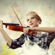Gorgeous woman playing on violin — Stok fotoğraf