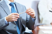 Hands of businessman laying on table — Stock Photo