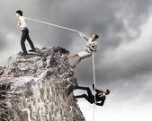 Three business pulling rope — Stock Photo