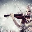 Gorgeous woman playing violin — Stockfoto