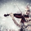 Gorgeous woman playing violin — Stok fotoğraf